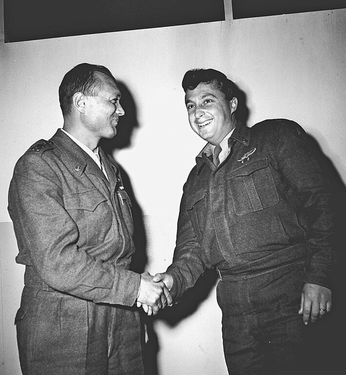 . This handout picture from the Israeli government press office\'s (GPO) archives dated 01 October 1955 shows General Moshe Dayan (L) shaking hands with Ariel Sharon at an undisclosed location in Israel. AFP PHOTO/HO/GPO-/AFP/Getty Images
