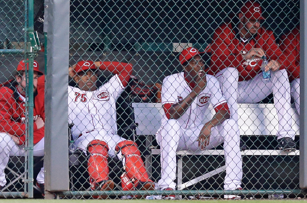 . From left to right, Cincinnati Reds\' Sam LeCure, Nilson Antigua, Aroldis Chapman and Logan Ondrusek sit in the bullpen in the fourth inning of a baseball game against the Colorado Rockies, Saturday, May 10, 2014, in Cincinnati. Chapman was activated early Saturday morning. (AP Photo/Al Behrman)