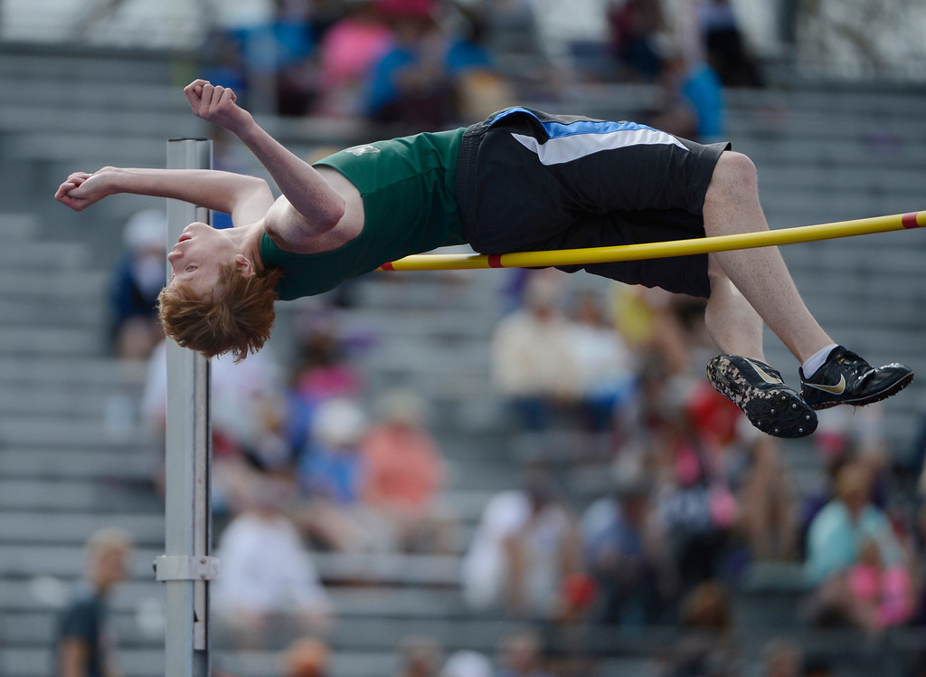 """. Jim Slaughter, Manitou Springs High School, attempts, but was unable to clear 6\'4\"""" during the boys 3A high jump final at the Colorado State Track and Field Championships at Jeffco Stadium, Saturday morning, May 18, 2013.  (AP Photo/The Denver Post, Andy Cross)"""
