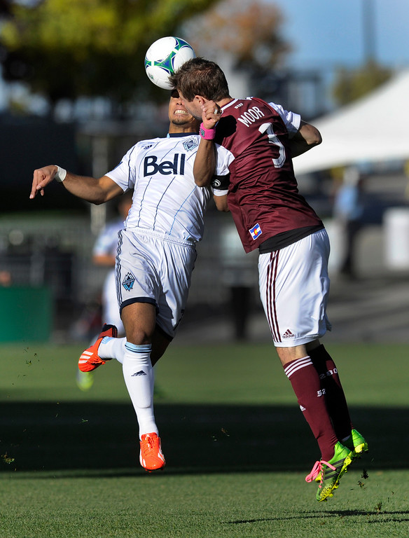 . COMMERCE CITY, CO. - OCTOBER 19: Vancouver forward Camilo Sanvezzo (7) collided with Colorado defender Drew Moor (3) as they both went for a header in the first half. The Colorado Rapids hosted the Vancouver Whitecaps at Dick\'s Sporting Goods Park Saturday, October 19, 2013. Photo By Karl Gehring/The Denver Post