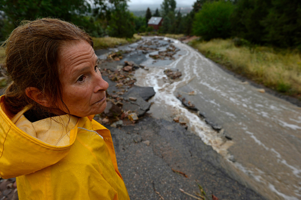. BOULDER, CO - SEPTEMBER 12: Kym Dabagian checks out the damage in her neighborhood in north Boulder, September 12, 2013. Massive flash flooding is on going along the Front Range of Colorado. (Photo By RJ Sangosti/The Denver Post)