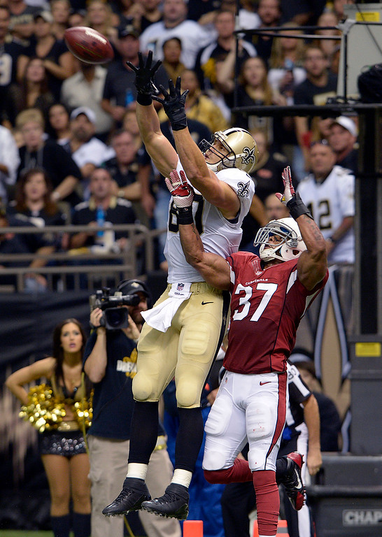. New Orleans Saints tight end Jimmy Graham (80) pulls in a touchdown reception over Arizona Cardinals strong safety Yeremiah Bell (37) in the first half of an NFL football game in New Orleans, Sunday, Sept. 22, 2013. (AP Photo/Bill Feig)
