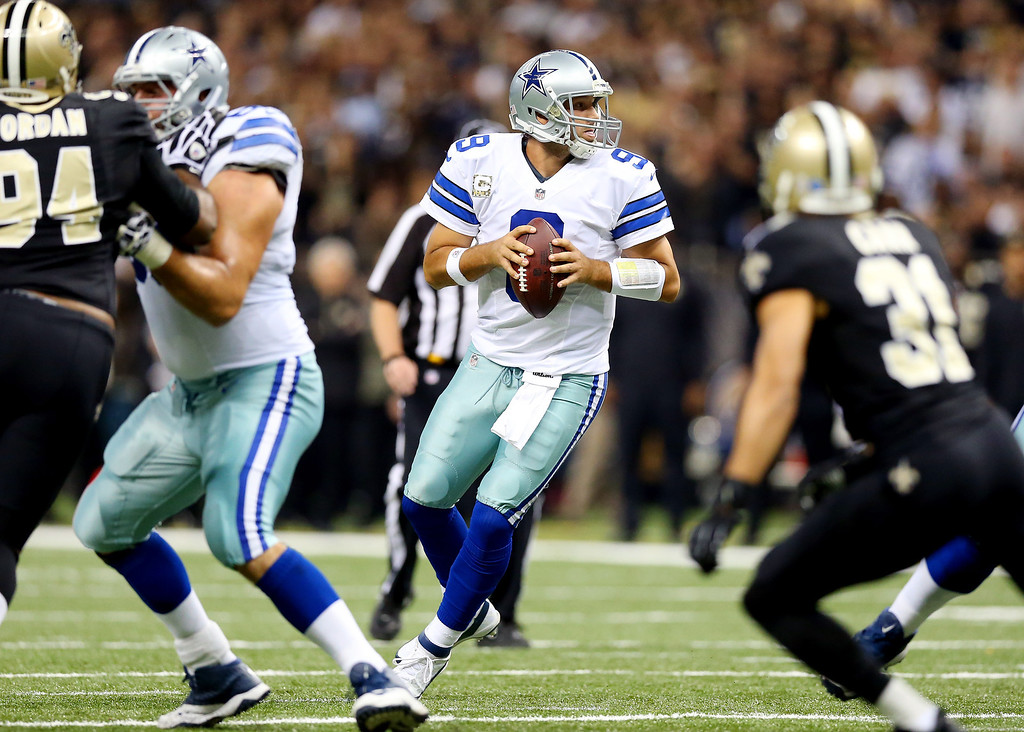 . Quarterback Tony Romo #9 of the Dallas Cowboys drops back to pass against the New Orleans Saints during a game at the Mercedes-Benz Superdome on November 10, 2013 in New Orleans, Louisiana.  (Photo by Ronald Martinez/Getty Images)