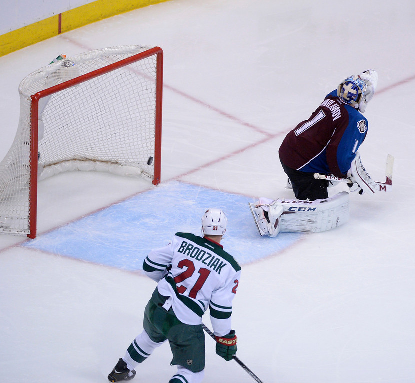. A shot by Nino Niederreiter (22) of the Minnesota Wild gets by Semyon Varlamov (1) of the Colorado Avalanche ends the game during overtime. (Photo by Karl Gehring/The Denver Post)