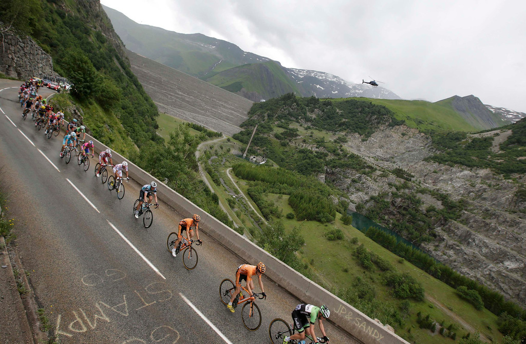 . A break away group of riders cycle during the 204.5 km nineteenth stage of the centenary Tour de France cycling race from Bourg d\'Oisans to Le Grand Bornand, in the French Alps, July 19, 2013.   REUTERS/Jacky Naegelen
