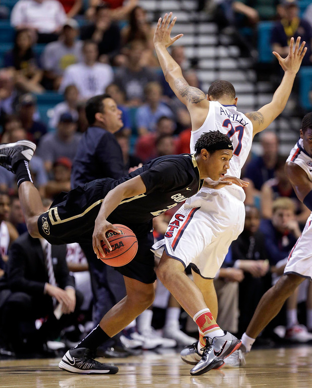 . Colorado\'s Xavier Johnson (2) is fouled by Arizona\'s Brandon Ashley (21) as he drives the ball around the perimeter in the first half during a Pac-12 tournament NCAA college basketball game, Thursday, March 14, 2013, in Las Vegas. (AP Photo/Julie Jacobson)