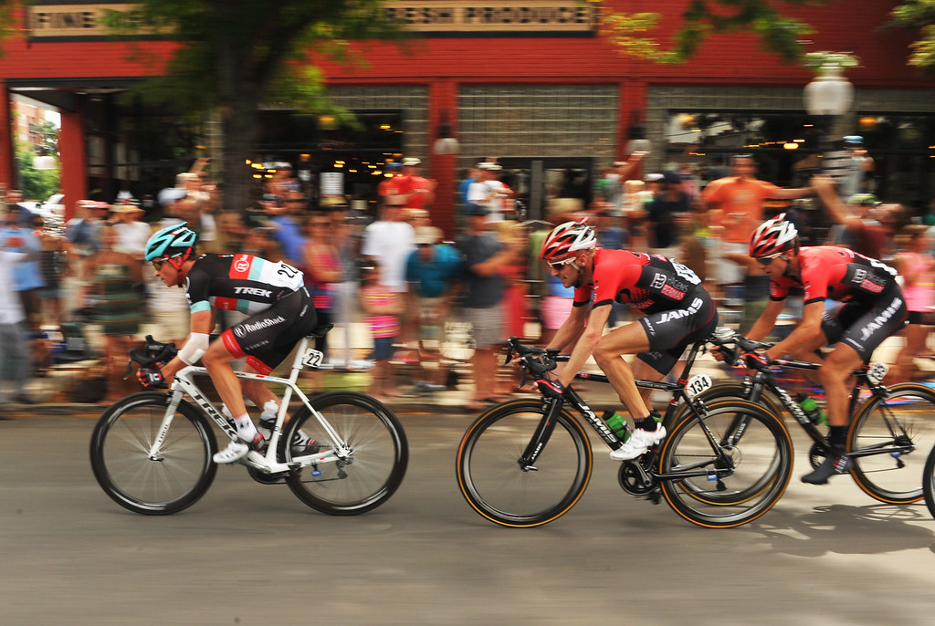 . Benjamin King of RadioShack (22), left, and the cyclists ride on 17th street during the 75-mile 7th stage of the 2013 USA Pro Challenge race in Denver, Colorado on August 25, 2013. (Photo by Hyoung Chang/The Denver Post)