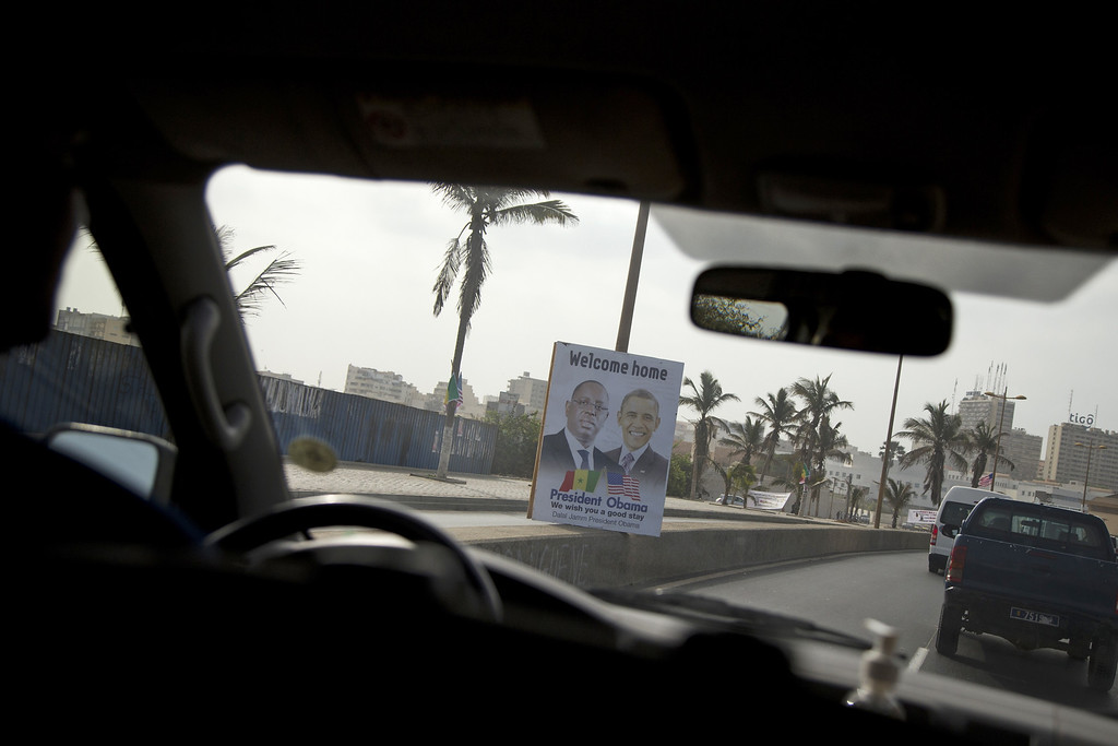 . Welcome signs line the motorcade route of President Barack Obama on his way to meet with Senegalese President Macky Sall at the Presidential Palace in Dakar, Senegal, Thursday, June 27, 2013. Obama is visiting Senegal, South Africa, and Tanzania on a week long trip. (AP Photo/Evan Vucci)