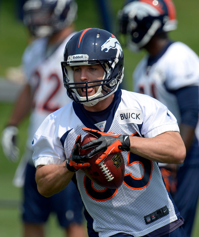 . Wes Welker (83) WR of the Denver Broncos catches a pass during drills on the last day of  minicamp June 13, 2013 at Dove Valley. (Photo By John Leyba/The Denver Post)