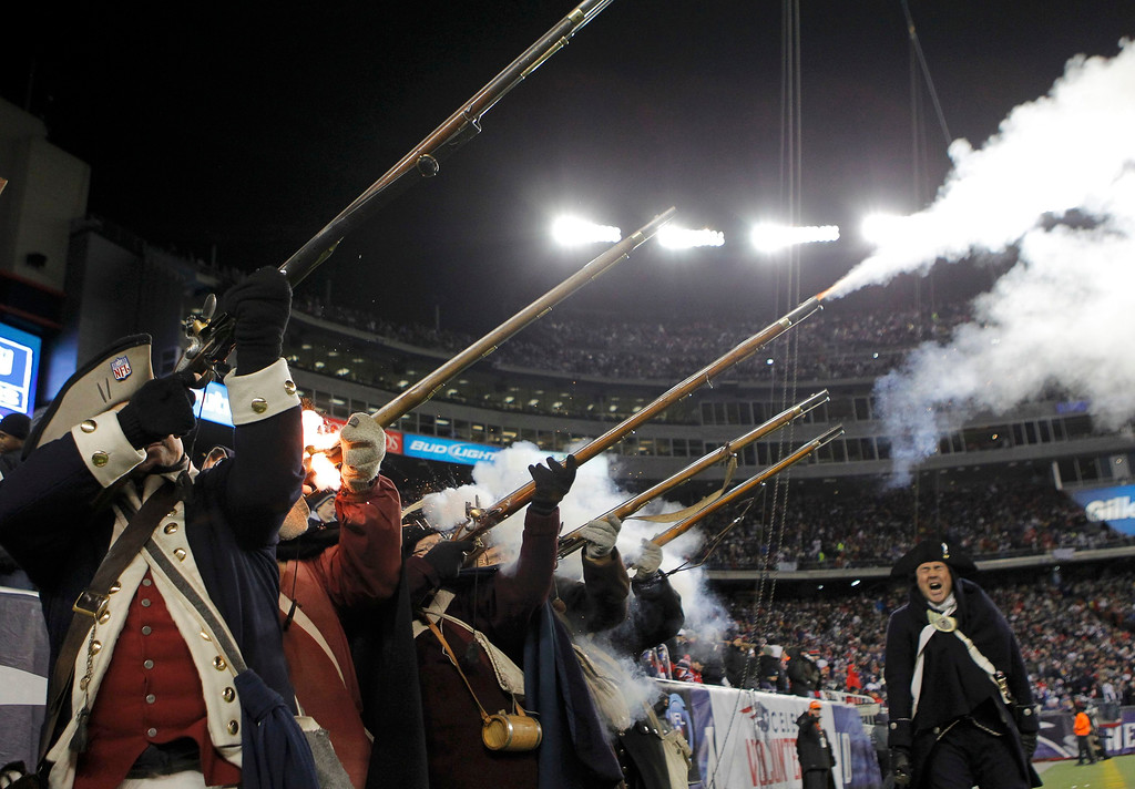 ". The ""End zone militia\"" celebrate a field goal by the New England Patriots against the Baltimore Ravens in the first quarter of the NFL AFC Championship football game in Foxborough, Massachusetts, January 20, 2013. REUTERS/Mike Segar"