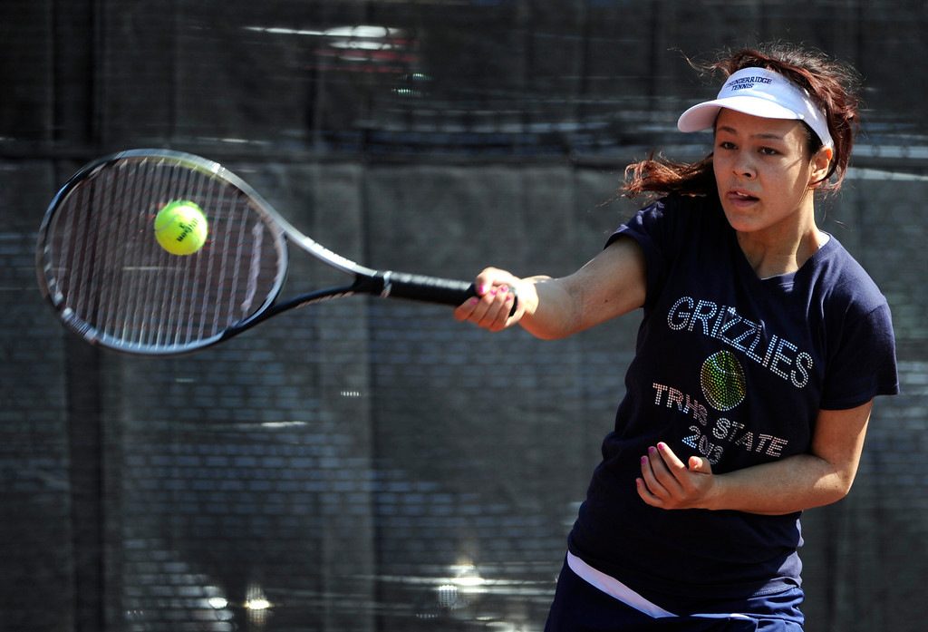 . Angelica Buczynski from ThunderRidge High School returns the ball to Katie Li from Fairview High School in the #3 Singles Bracket. (Photo By Kathryn Scott Osler/The Denver Post)