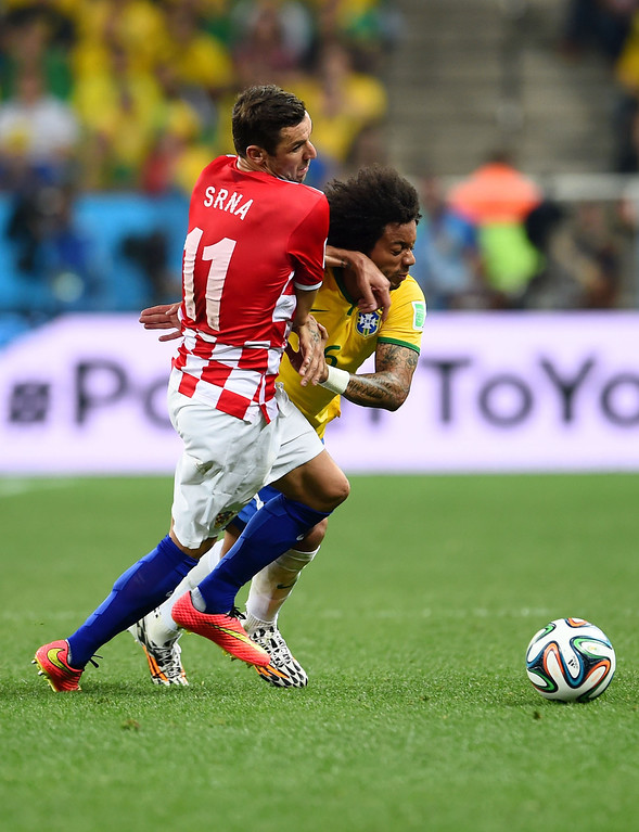 . Darijo Srna of Croatia and Marcelo of Brazil battle for the ball during the 2014 FIFA World Cup Brazil Group A match between Brazil and Croatia at Arena de Sao Paulo on June 12, 2014 in Sao Paulo, Brazil.  (Photo by Buda Mendes/Getty Images)