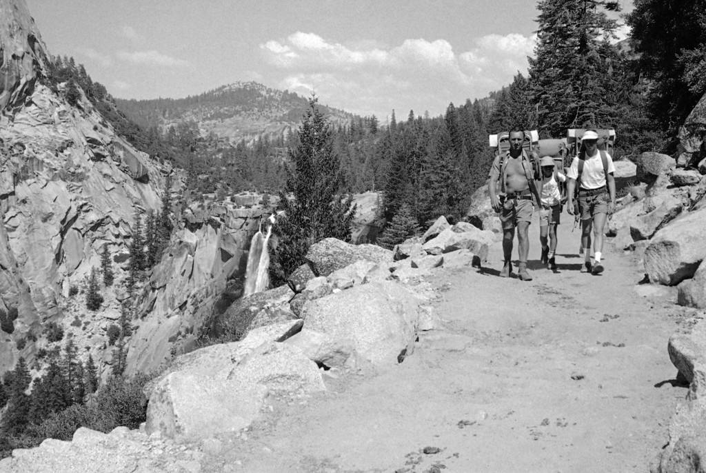 """. Yosemite National Park is still beautiful but hardly untrodden: the John Muir trail, for example, near the Nevada Falls, left, bears the imprints of thousands of hikers boots on Sept. 6, 1972. In 1894, the naturalist-mountaineer, John Muir, wrote about \""""Sierra solitude.\"""" (AP Photo/William Straeter)"""