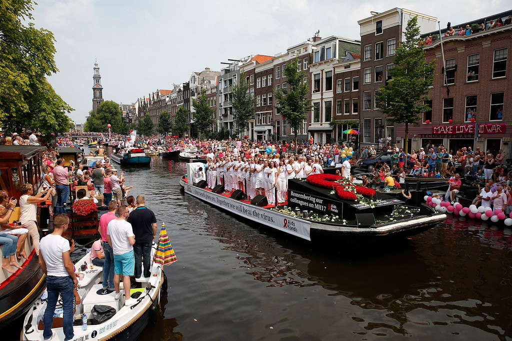 . Dutch people pay tribute to the victims of Malaysia Airlines flight MH17 at the start of the Canal Parade of Gay Pride in Amsterdam on August 2, 2014. The plane with 298 people on board came down on July 17 in an area of east Ukraine where pro-Russian separatists are battling government forces. BAS CZERWINSKI/AFP/Getty Images