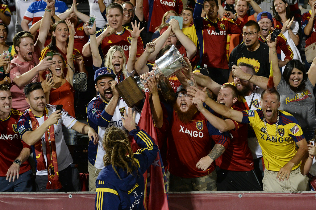 . COMMERCE CITY, CO - AUGUST 1: Salt Lake captain Kyle Beckerman handed off the Rocky Mountain Cup to fans following the win Saturday night. Real Salt Lake defeated the Colorado Rapids 1-0 at Dick\'s Sporting Goods Park Saturday night, August 1, 2014.  Photo by Karl Gehring/The Denver Post