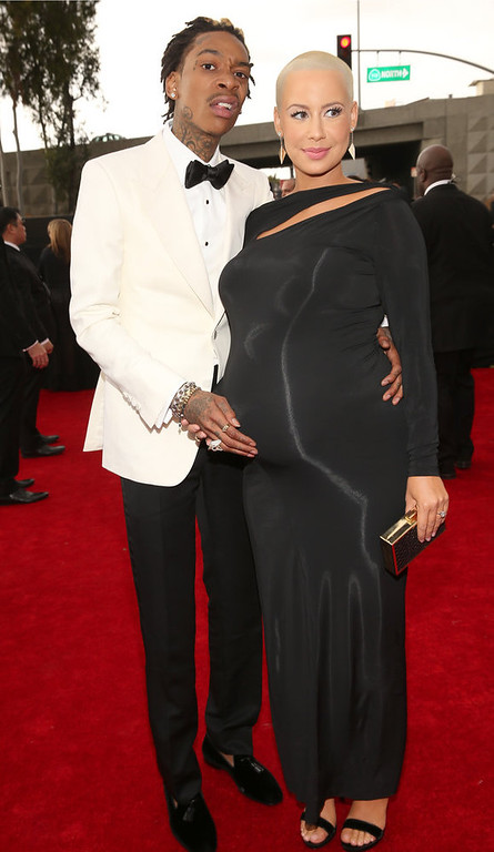 . Rapper Wiz Khalifa (L) and model Amber Rose attend the 55th Annual GRAMMY Awards at STAPLES Center on February 10, 2013 in Los Angeles, California.  (Photo by Christopher Polk/Getty Images for NARAS)