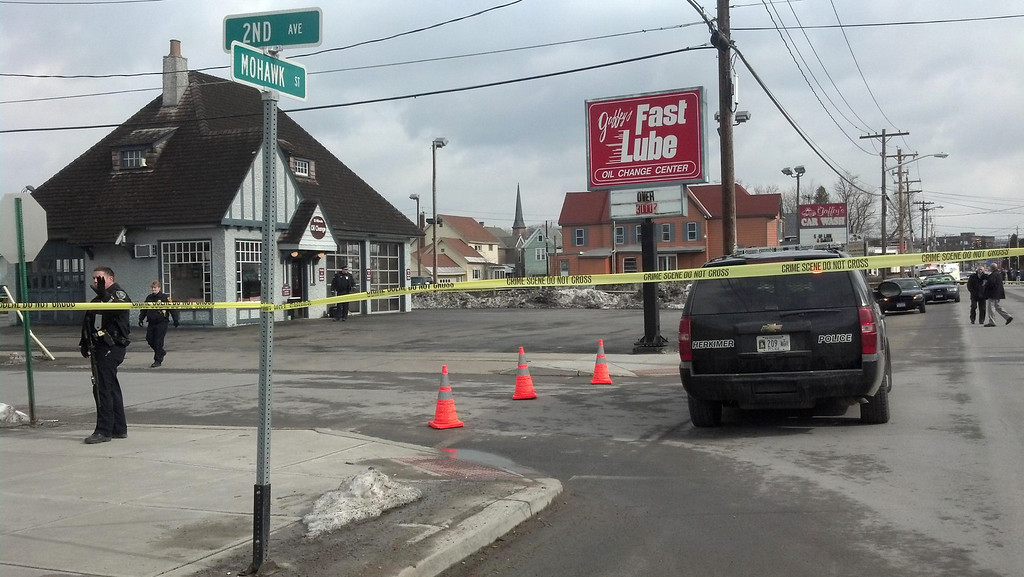 . Emergency crews work at the scene of a shooting at Gaffey\'s car wash in the village of Herkimer, N.Y.  after shootings at two different businesses left four people dead and at least two wounded, according to police, Wednesday, March 13, 2013.  (AP Photo/Observer-Dispatch, Rocco Laduca)
