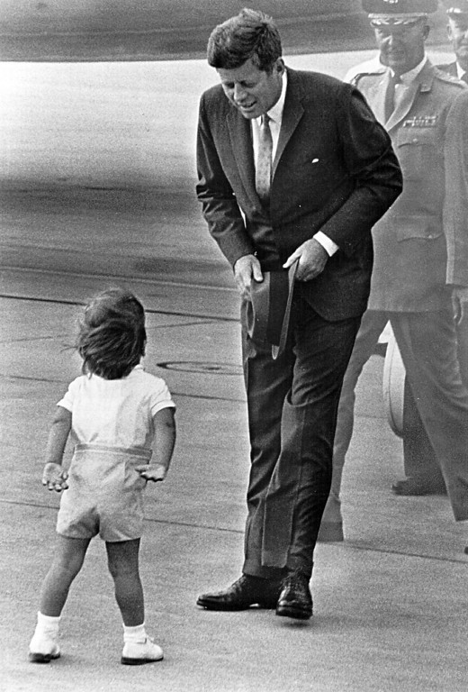 . President Kennedy greets John Jr. Newsmakers