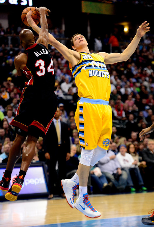 . Ray Allen (34) of the Miami Heat defends Timofey Mozgov (25) of the Denver Nuggets during the first half at the Pepsi Center in Denver on December 30, 2013. (Photo by AAron Ontiveroz/The Denver Post)