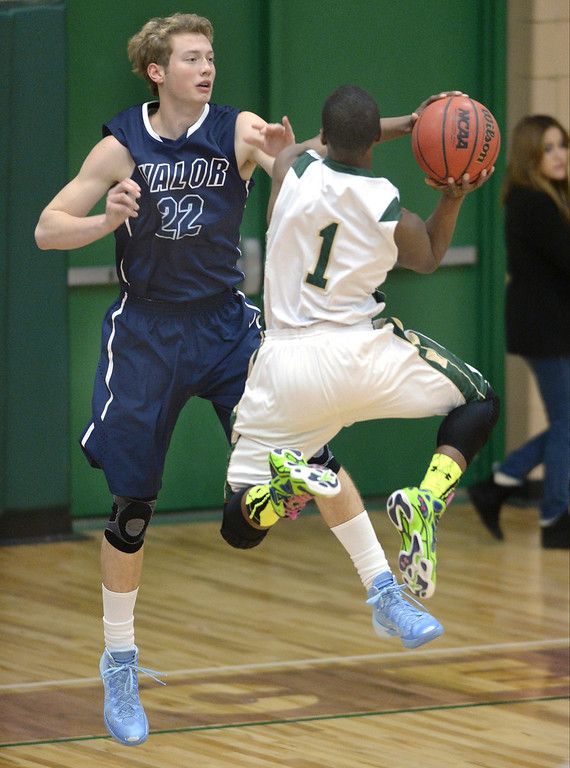 . Aurora Central sophomore LaDarius Thomas (1) drove the lane against Valor\'s Chase Foster (22) in the first half. The Valor Christian High School boy\'s basketball team defeated Aurora Central 60-52 Wednesday night, January 8, 2014. Photo By Karl Gehring/The Denver Post