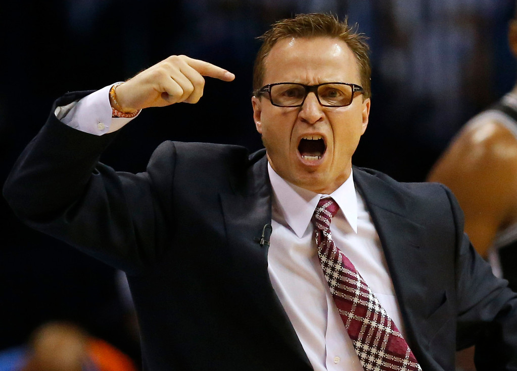 . Oklahoma City Thunder coach Scott Brooks reacts to a call during the the second half against the San Antonio Spurs in Game 6 of the Western Conference finals NBA basketball playoff series in Oklahoma City, Saturday, May 31, 2014. (AP Photo/Sue Ogrocki)