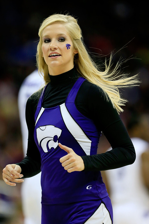. KANSAS CITY, MO - MARCH 22: A Kansas State Wildcats cheerleader performs in the first half against the La Salle Explorers during the second round of the 2013 NCAA Men\'s Basketball Tournament at the Sprint Center on March 22, 2013 in Kansas City, Missouri.  (Photo by Jamie Squire/Getty Images)