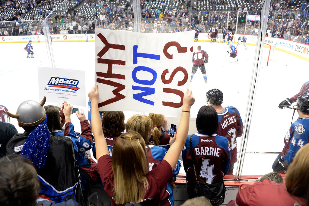 . A fan holds up a Why not us? poster prior to the first period of action. The Colorado Avalanche hosted the Minnesota Wild in the first round of the Stanley Cup Playoffs at the Pepsi Center in Denver, Colorado on Saturday, April 19, 2014. (Photo by John Leyba/The Denver Post)