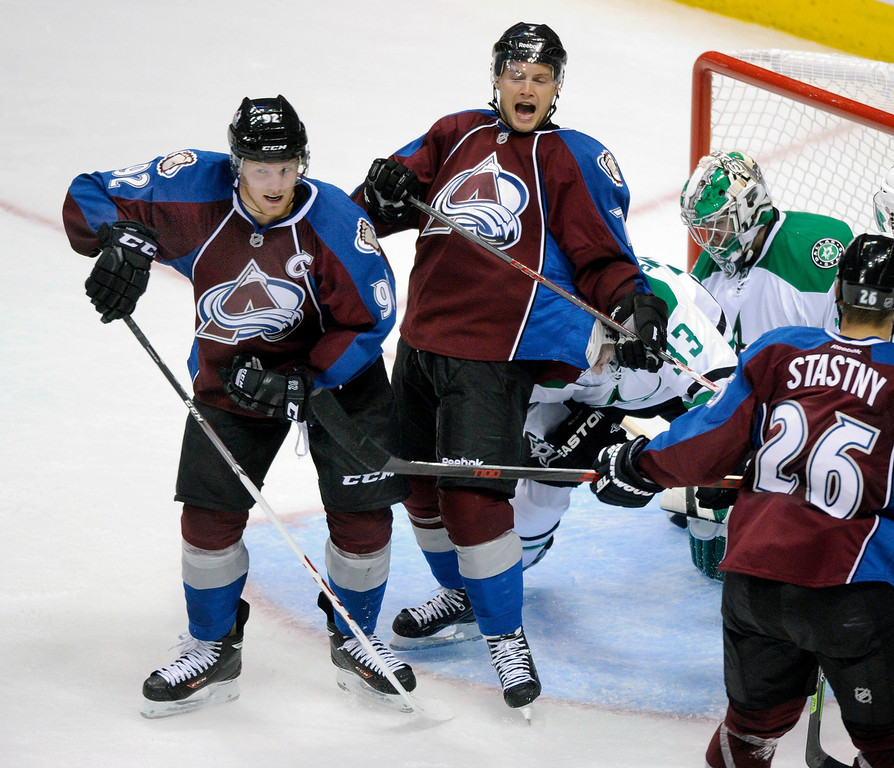 . Gabriel Landeskog (92) and John Mitchell (7) celebrated after the Swedish wing found the back of the net in the second period.   Photo By Karl Gehring/The Denver Post