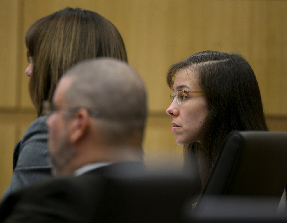 . Jodi Arias listens during her trial at Maricopa County Superior Court in Phoenix on Tuesday, April 16, 2013. Defense attorneys rested their case Tuesday after about 2 1/2 months of testimony aimed at portraying Arias as a domestic violence victim who fought for her life the day she killed her one-time boyfriend.  (AP Photo/The Arizona Republic, David Wallace, Pool)