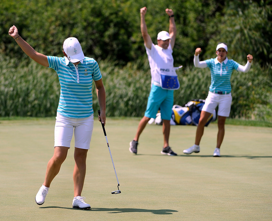 . PARKER, CO - Aug.17: Team Europe\'s Azahara Munoz, right, joins in the celebration Karine Icher, left, makes her putt on the 17th hole. The 2013 Solheim Cup takes place at the Colorado Golf Club with the USA taking on Europe in the Saturday morning Foursomes Match. (Photo By Kathryn Scott Osler/The Denver Post)