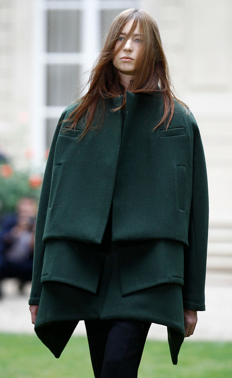 . A model wears a creation for Rad Hourani\'s fall-winter 2014-2015 Haute Couture fashion collection presented in Paris, France, Wednesday, July 9, 2014. (AP Photo/Remy de la Mauviniere)