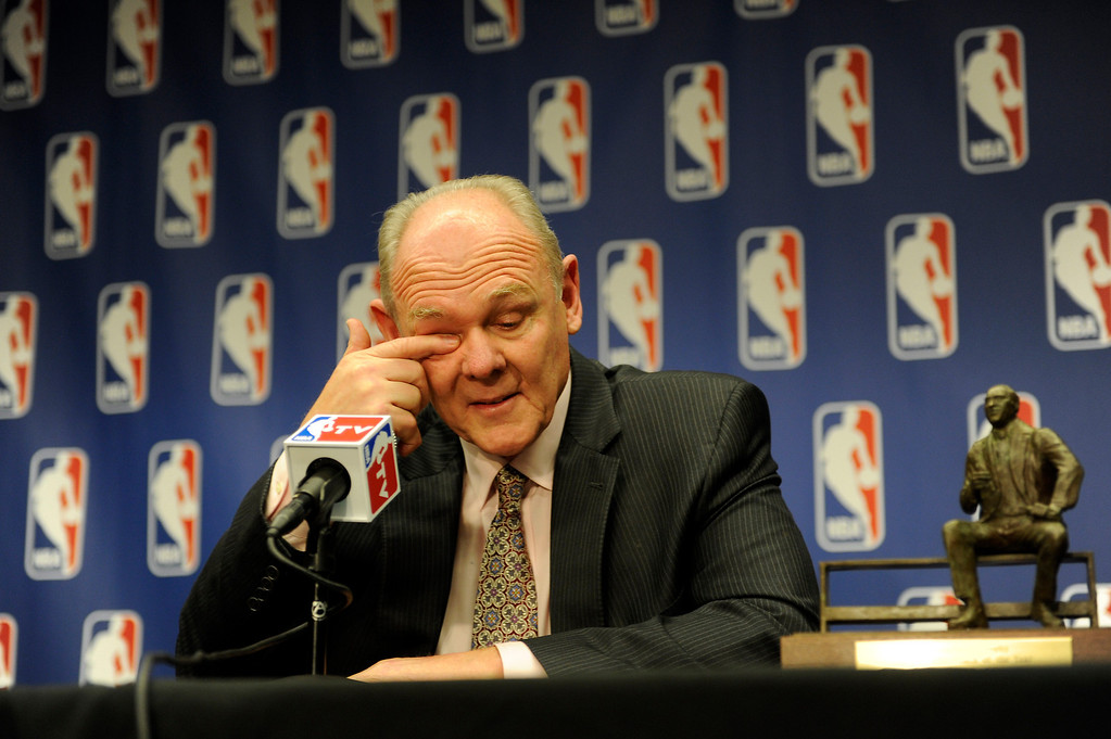 """. Denver Nuggets Head Coach George Karl becomes emotional after accepting the 2012-13 NBA Coach of the Year Award at the Pepsi Center on Wednesday, May 8, 2013. \""""Probably my best friend in coaching I lost this year, in Rick Majerus. There were a lot of days I fought, because I miss him a lot,\"""" said Karl.   (Photo By Lindsay Pierce/The Denver Post)"""
