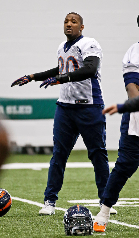 . Denver Broncos defensive end Shaun Phillips stretches during practice Thursday, Jan. 30, 2014, in Florham Park, N.J. The Broncos are scheduled to play the Seattle Seahawks in the NFL Super Bowl XLVIII football game Sunday, Feb. 2, in East Rutherford, N.J. (AP Photo)