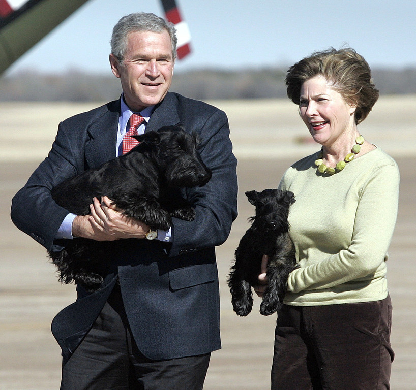 . This Dec. 26, 2005 file photo shows President Bush and first lady, Laura, as they carry their Scottish Terriers, Barney and Miss Beazley, respectively, before departing from Waco, Texas on Marine One on their way to their ranch in Crawford.  Any president-elect has to make appointments to many important offices. But Barack Obama has additional burden: although most presidents have brought a First Dog with them, his family has yet to fill that position.   (AP Photo/Lawrence Jackson, FILE)