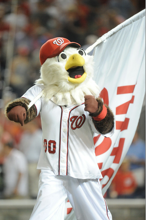 . The Washington Nationals mascot Screech celebrates a win after a baseball against the Colorado Rockies on July 2, 2014 at Nationals Park in Washington, DC.  The Nationals won 4-3. (Photo by Mitchell Layton/Getty Images)