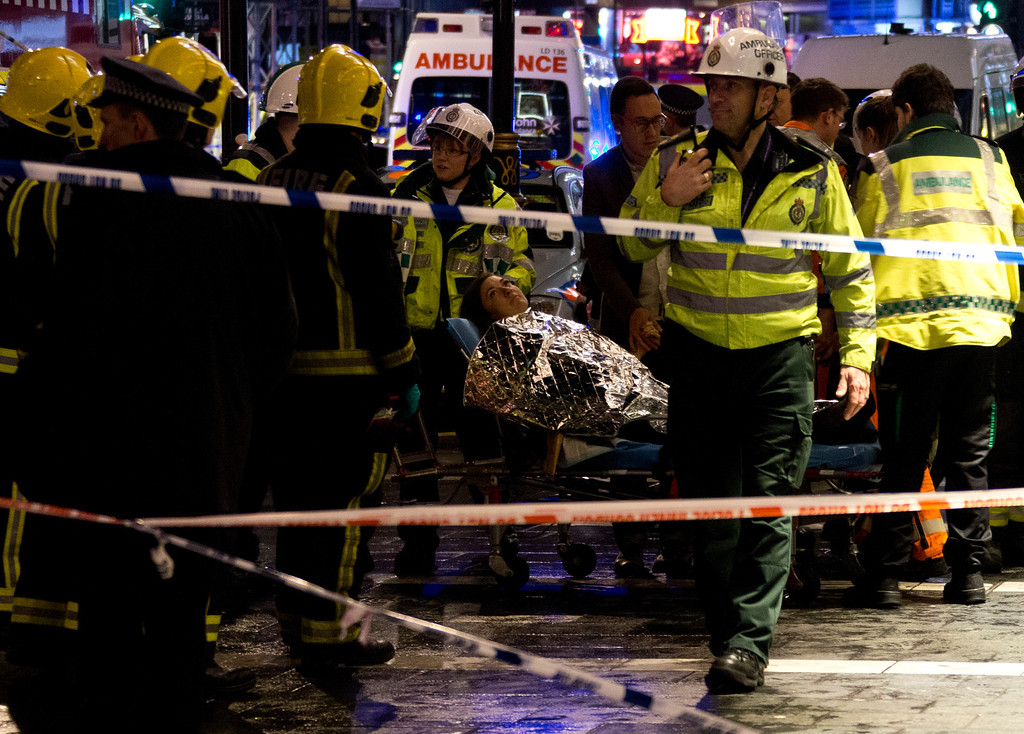 ". A woman lies on a stretcher surrounded  by rescue workers, awaiting evacuation  following an incident during a performance at the Apollo Theatre, in London\'s Shaftesbury Avenue, Thursday evening, Dec. 19, 2013, with police saying there were ""a number\"" of casualties. It wasn\'t immediately clear which part of the building had collapsed. The London Fire Brigade said the theatre was almost full, with around 700 people watching the performance. A spokesman added: \""It\'s thought between 20 and 40 people were injured.\"" (AP Photo by Joel Ryan, Invision)"