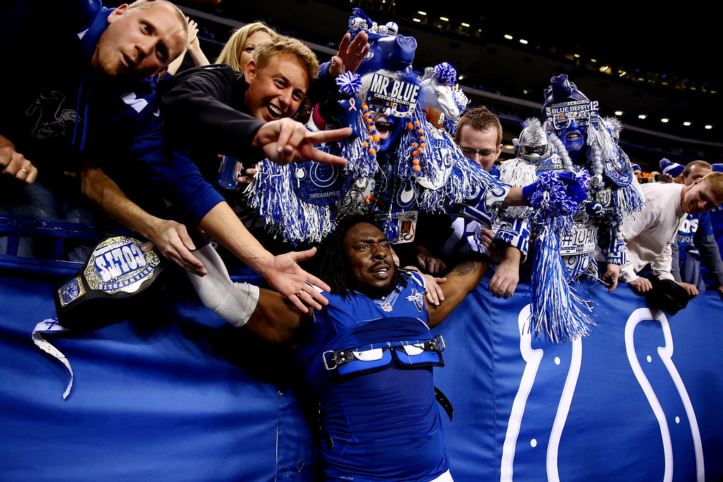 . INDIANAPOLIS, IN - JANUARY 04: Defensive end Ricky Jean Francois #99 of the Indianapolis Colts celebrates with fans after defeating the Kansas City Chiefs 45-44 in a Wild Card Playoff game at Lucas Oil Stadium on January 4, 2014 in Indianapolis, Indiana.  (Photo by Andy Lyons/Getty Images)