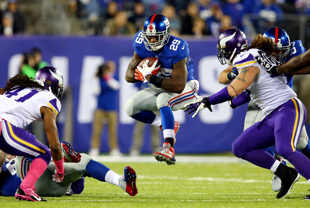 . Running back Michael Cox #29 of the New York Giants avoids a tackle against the Minnesota Vikings during a game at MetLife Stadium on October 21, 2013 in East Rutherford, New Jersey.  (Photo by Elsa/Getty Images)
