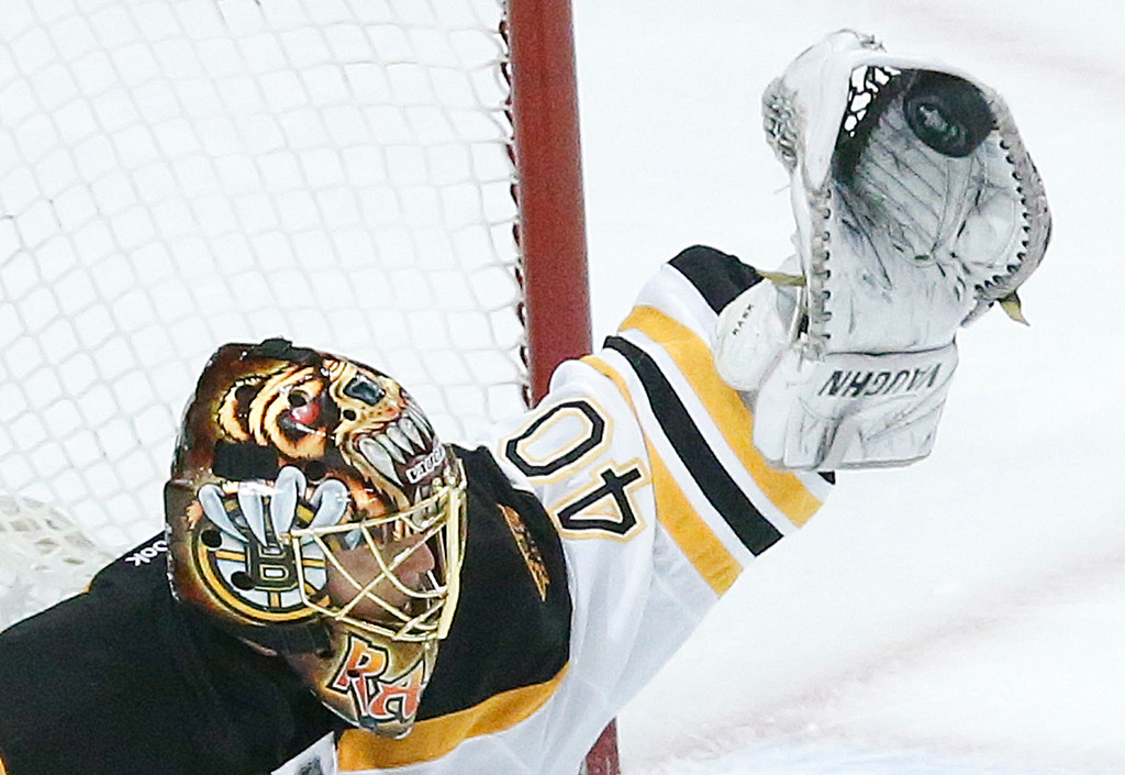 . Boston Bruins goalie Tuukka Rask (40) gloves the puck against the Chicago Blackhawks during Game 5 of the NHL hockey Stanley Cup Finals, Saturday, June 22, 2013, in Chicago. (AP Photo/Charles Rex Arbogast)
