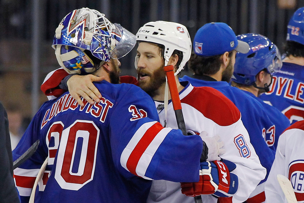 . Henrik Lundqvist #30 of the New York Rangers hugs Brandon Prust #8 of the Montreal Canadiens after defeating the Montreal Canadiens in Game Six to win the Eastern Conference Final in the 2014 NHL Stanley Cup Playoffs at Madison Square Garden on May 29, 2014 in New York City. The New York Rangers defeated the Montreal Canadiens 1 to 0.  (Photo by Mike Stobe/Getty Images)