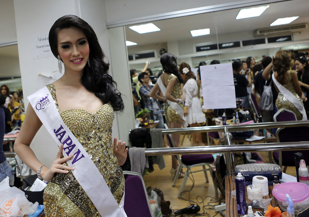 . Satsuki Nishihara of Japan poses backstage at the Miss International Queen 2013 transgender beauty pageant in Pattaya, southeastern Thailand Friday, Nov. 1, 2013. Twenty-five contestants from 17 countries participate at this year Miss International Queen which has been held for nine respective years. (AP Photo/Apichart Weerawong)