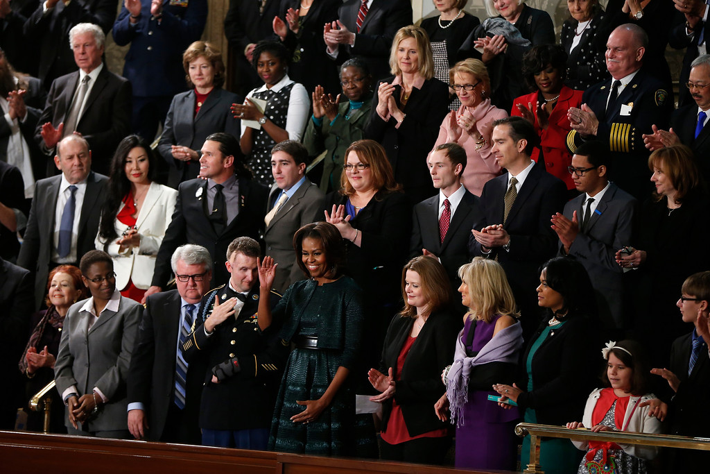 . First lady Michelle Obama waves as she arrives for President Barack Obama\'s State of the Union address on Capitol Hill in Washington, Tuesday Jan. 28, 2014. (AP Photo/Charles Dharapak)