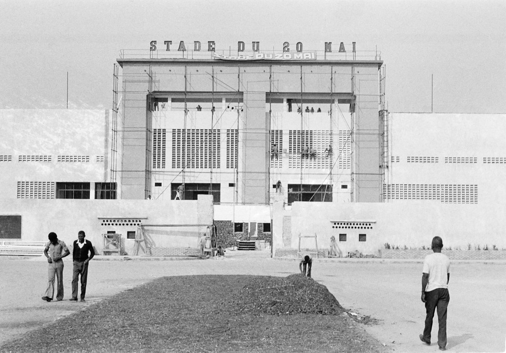 . Workers are busy with preparations on  August 12, 1974  at the main entrance of the May 20 Stadium in Kinshasa, Zaire  for the world heavyweight championship scheduled for Sept. 24th  between George Foreman and Muhammad Ali.  The stadium, with a capacity of 62,800 is being almost entirely rebuilt.   The fight had to be rescheduled to October 30, 1974 after Foreman needed to recover from an eye injury during his training.   (AP Photo)