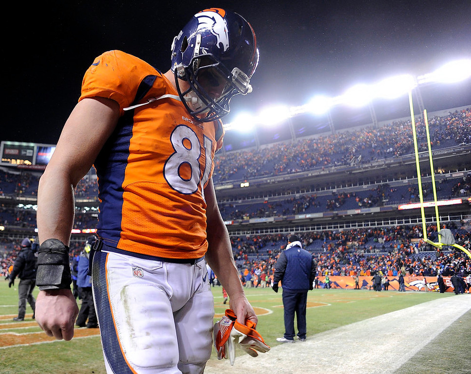 . Denver Broncos tight end Joel Dreessen (81) walks off the field after losing to the Baltimore Ravens 35 to 38.  The Denver Broncos vs Baltimore Ravens AFC Divisional playoff game at Sports Authority Field Saturday January 12, 2013. (Photo by John Leyba,/The Denver Post)
