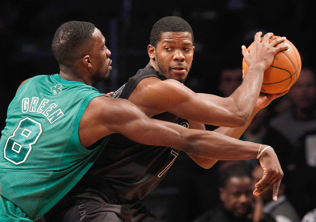 . NEW YORK, NY - DECEMBER 25:  Jeff Green #8 of the Boston Celtics defends against Joe Johnson #7 of the Brooklyn Nets at the Barclays Center on December 25, 2012 in the Brooklyn borough of New York City. The Boston Celtics defeated the Brooklyn Nets 93-76.  (Photo by Mike Stobe/Getty Images)