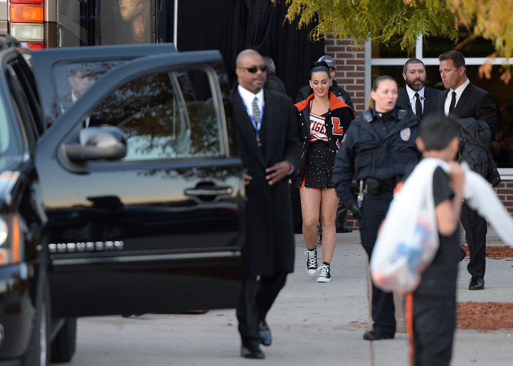 . Katy Perry leaves after performing at Lakewood High School, October 25, 2013. About 2,700 students and faculty attended the concert. (Photo By RJ Sangosti/The Denver Post)