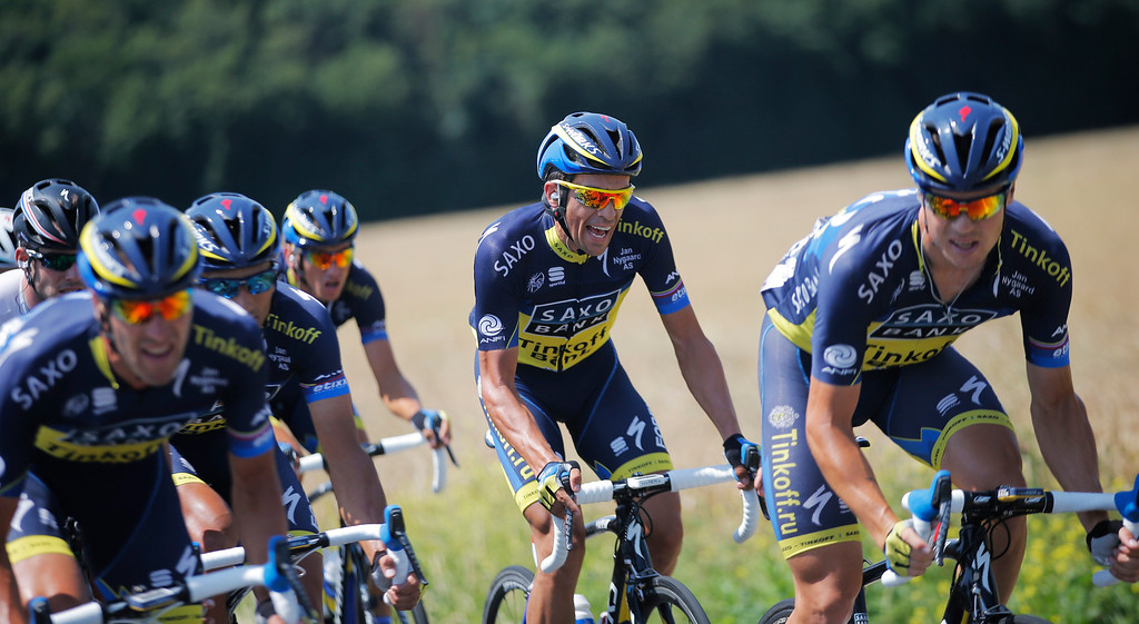 . Spain\'s Alberto Contador, center, grimaces as he rides with his teammates during the thirteenth stage of the Tour de France cycling race over 173 kilometers (108.1 miles) with start in in Tours and finish in Saint-Amand-Montrond, western France, Friday July 12 2013. (AP Photo/Christophe Ena)
