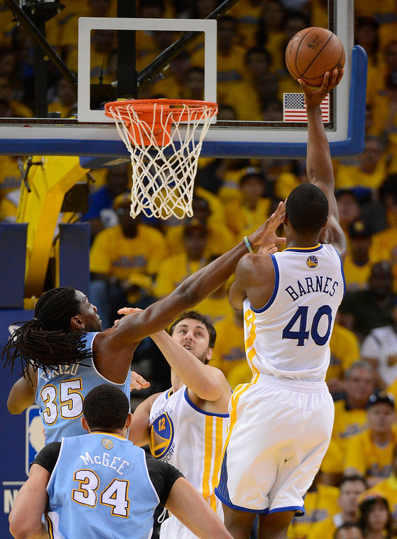 . Harrison Barnes (40) of the Golden State Warriors goes up for a shot over Kenneth Faried (35) of the Denver Nuggets during the second quarter in Game 6 of the first round NBA Playoffs May 2, 2013 at Oracle Arena. (Photo By John Leyba/The Denver Post)