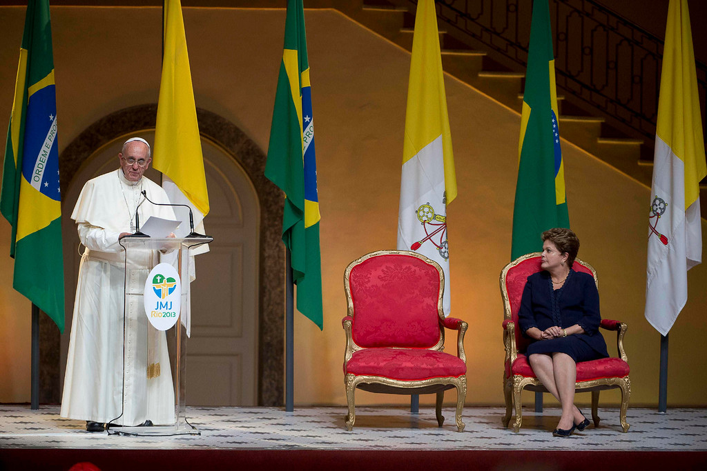 . Pope Francis speaks next to Brazil\'s President Dilma Rousseff during a welcoming ceremony for him in Guanabara Palace in Rio de Janeiro, July 22, 2013. Pope Francis touched down in Rio de Janeiro on Monday, starting his first foreign trip as pontiff and a weeklong series of events expected to attract more than a million people to a gathering of young faithful in Brazil, home to the world\'s largest Roman Catholic population. Picture taken July 22, 2013. REUTERS/Osservatore Romano/Handout via Reuters