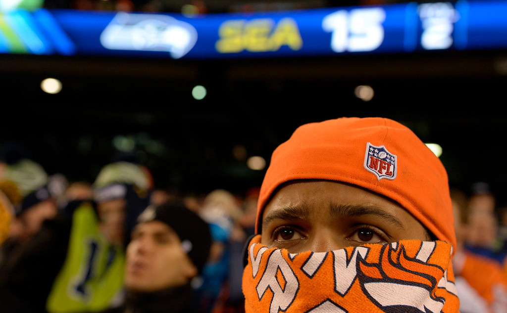 . Zach Henry of Orlando, Florida watches the game during the second quarter.  The Denver Broncos vs the Seattle Seahawks in Super Bowl XLVIII at MetLife Stadium in East Rutherford, New Jersey Sunday, February 2, 2014. (Photo by Craig F. Walker/The Denver Post)